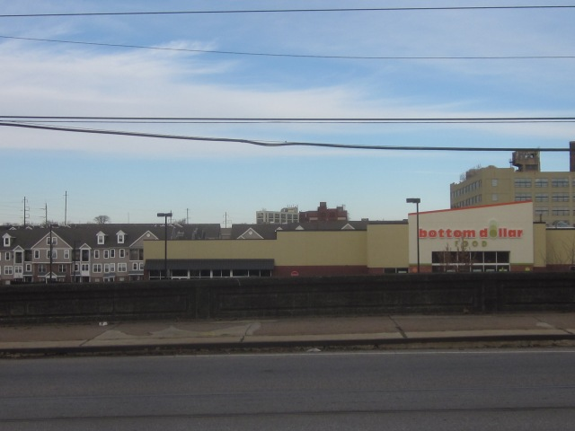 Bottom Dollar Food store on Girard Avenue, with Brewerytown stacked townhouses, Red Bell Brewery, and 3101 Glenwood in the background