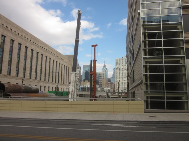 Construction site imbetween IRS building and garage, with Center City skyline in the background to the east