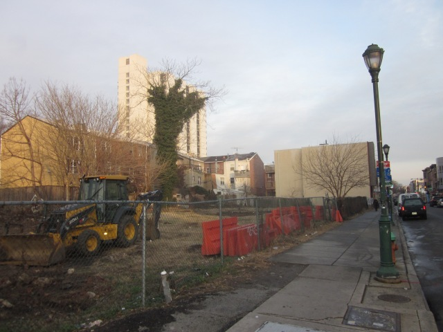 Construction equipment on the site, along South Street