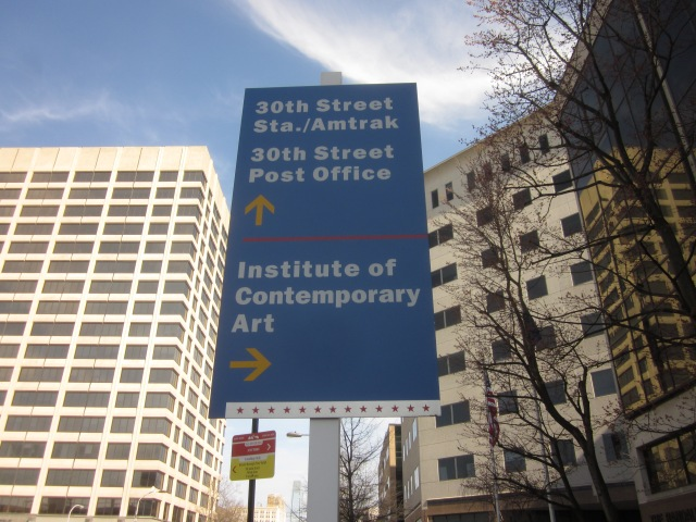 Sign announcing neighborhood landmarks and institutions