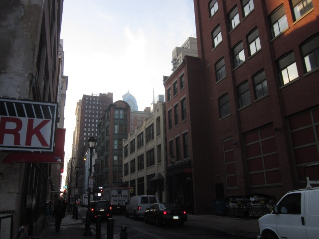 Looking west on Sansom Street, with tops of Liberty Place and Comcast Center visible in the background