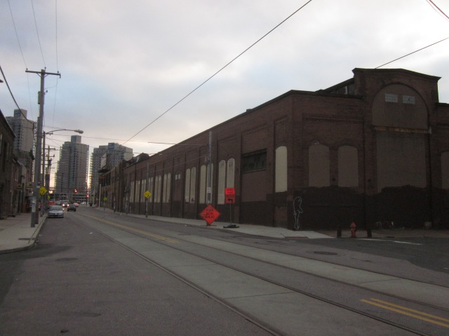 Looking east on Frankford Avenue at Ajax warehouse and Waterfront Square Condominiums in the background