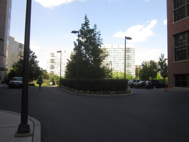 End of the driveway, in front of the entrance to the highrise