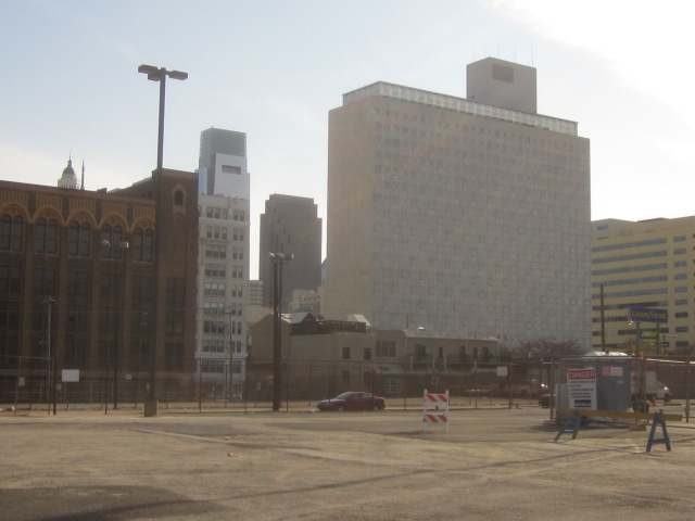 Tower Place, the former State Office Building, to the right and the former Stevens School to the left