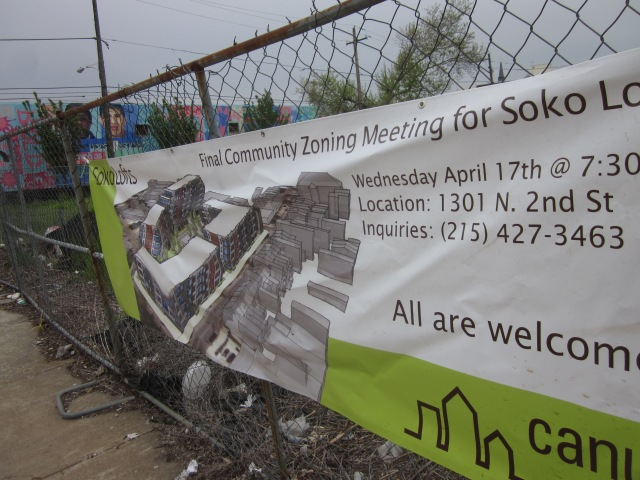 Sign announcing community meeting about Soko Lofts