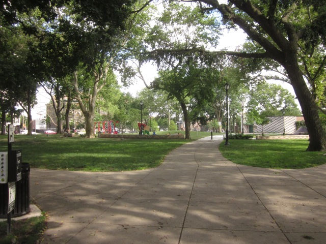 Looking into Dickinson Square Park from the northwest corner, at Fourth and Tasker Streets