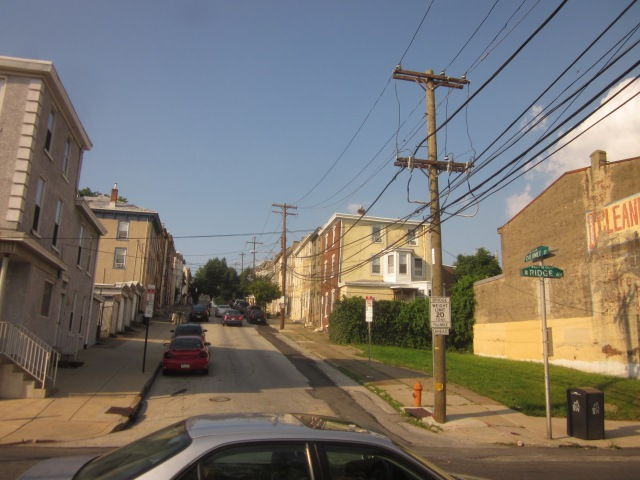 Looking up the staggered block of Calumet Street, east of Ridge Avenue and south of Heritage Drive and Falls Ridge, shows East Falls' steep hills leading away from the river