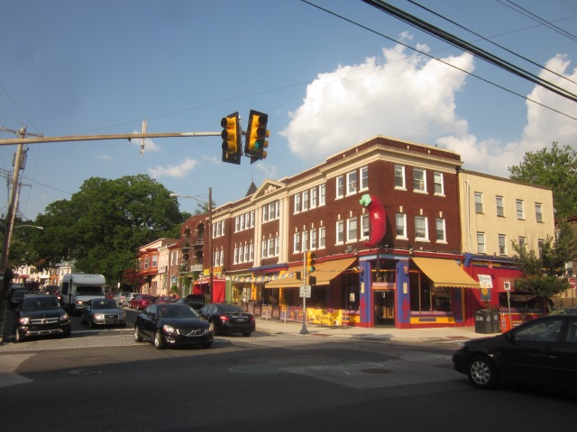 Johnny Manana's, with its landmark chili pepper, and other businesses at the intersection of Ridge and Midvale Avenues