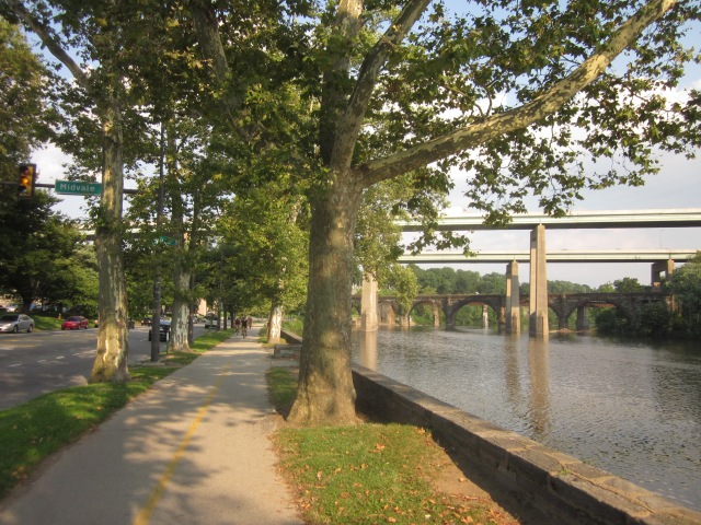 Cyclists can be seen along the river walk and bike path in Fairmount Park