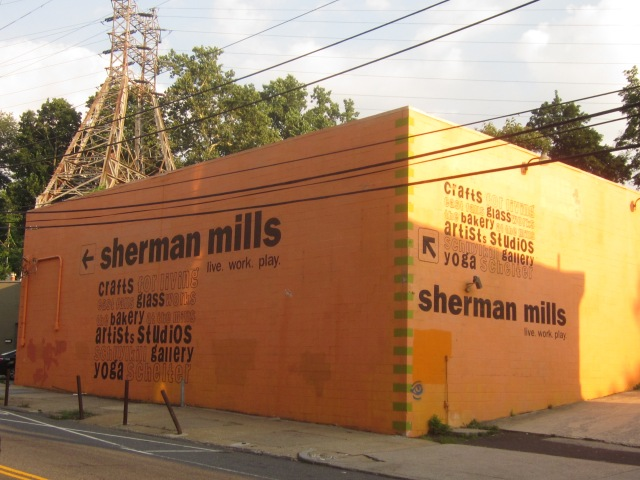 Mural, on Ridge Avenue, announcing Sherman Mills, which is off of Ridge