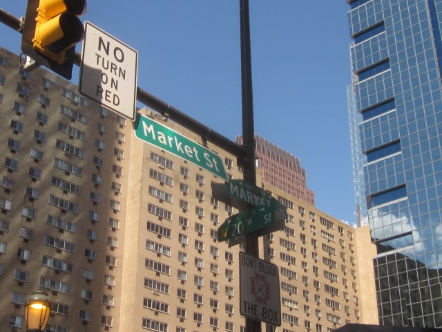 Street signs at 20th & Market Streets