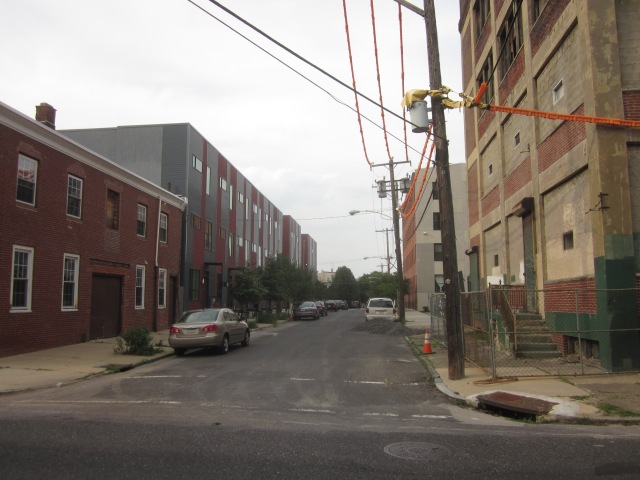 Looking down Tulip Street shows Memphis Flats next door and modern townhouses across the street