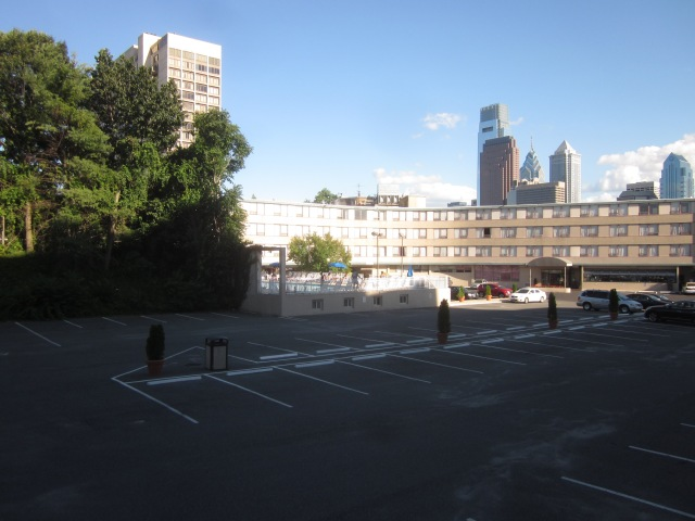 Looking at Best Western parking lot, from 22nd Street, where demolished hotel building was