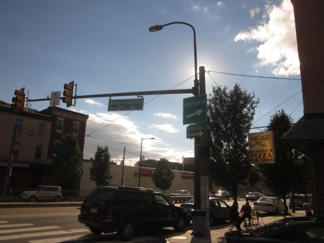 Street signs for American Street, at Girard Avenue