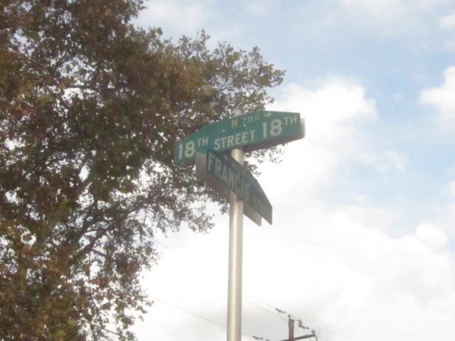 Street signs at 18th and Francis Streets