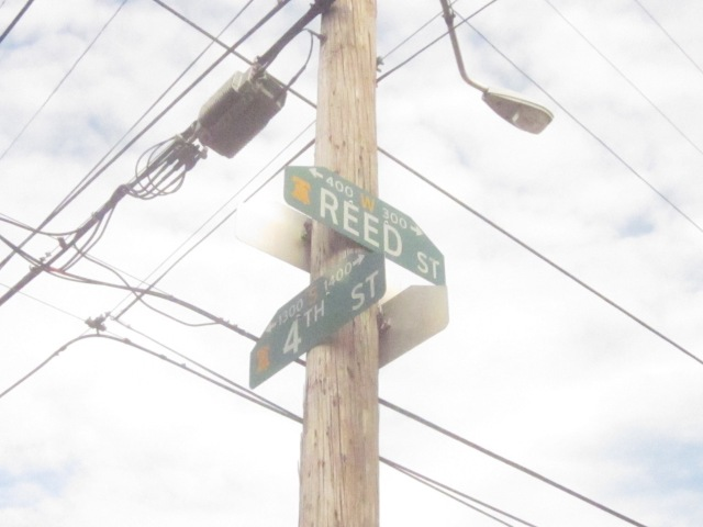 Street signs at Fourth and Reed Streets