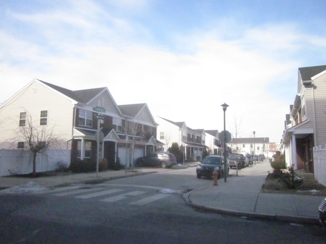 Expansive rowhomes built by Jefferson Square Community Development Corporation, across Reed Street from Mt. Sinai Hospital