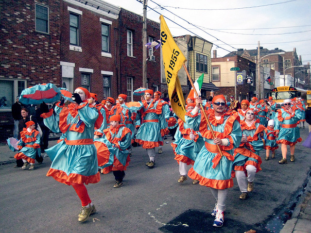 Mummers marching through Pennsport on 2 Street (Second Street)