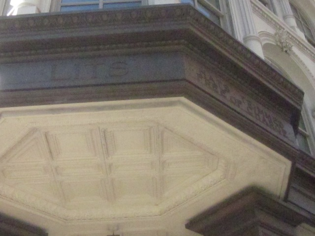 "Inscription at each corner on Market Street has famous expression, ""Hats Trimmed Free of Charge"""